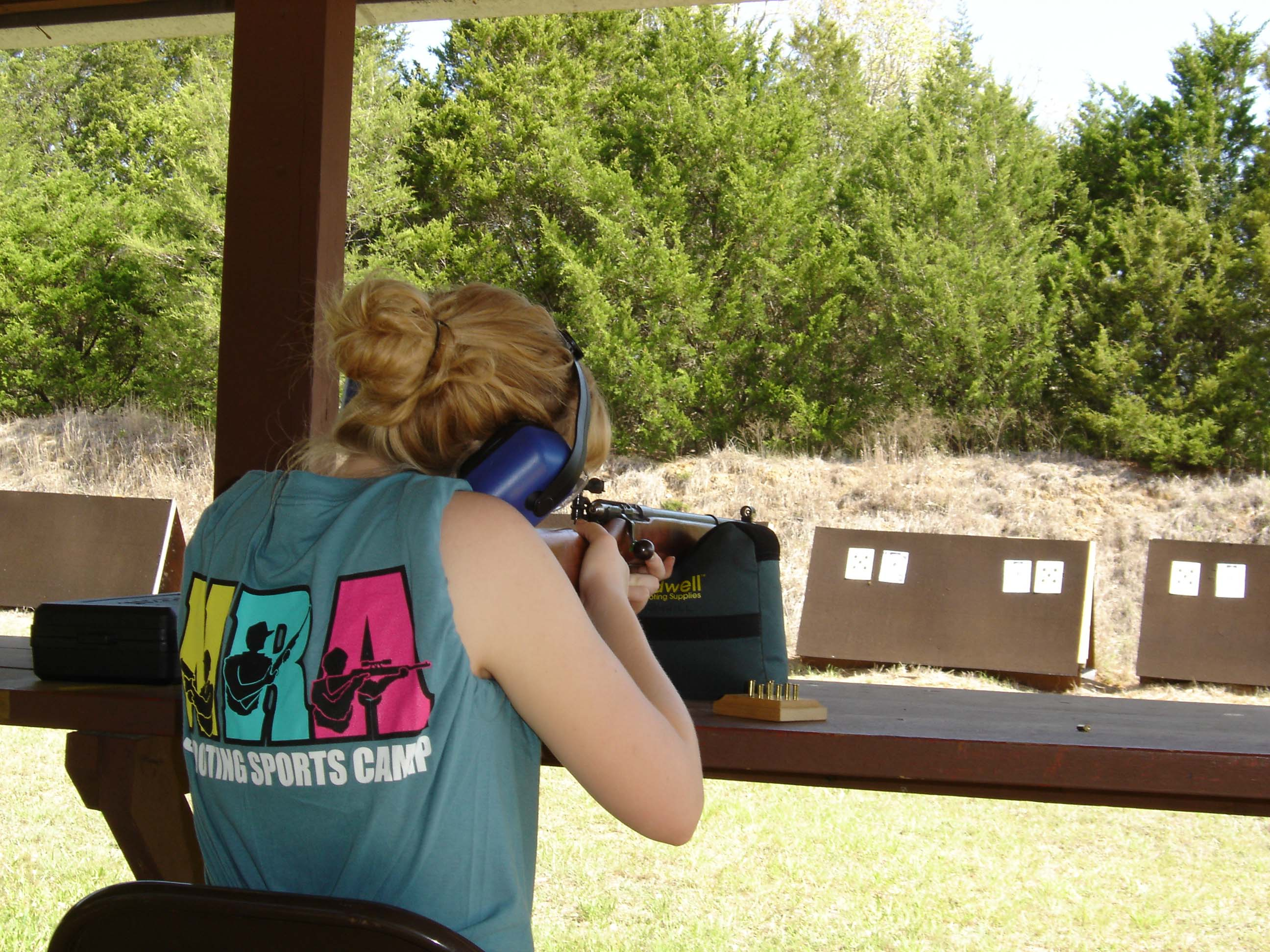 girl shooting rifle